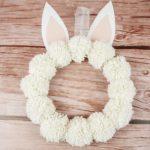 Pom Pom wreath against wooden background