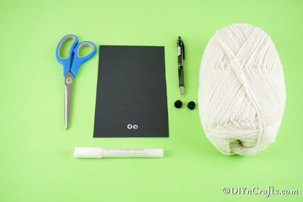 Supplies for making pom pom sheep