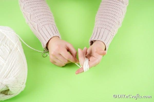 Winding yarn around hand