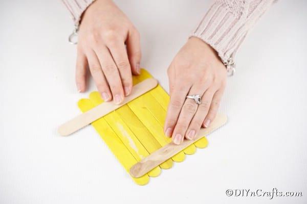 Gluing craft sticks together