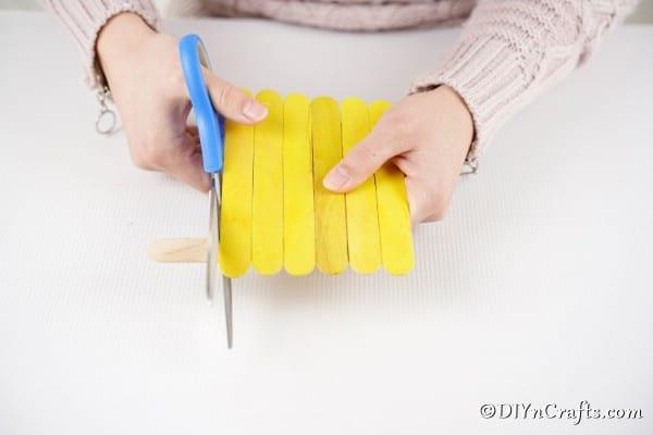 Trimming excess craft sticks