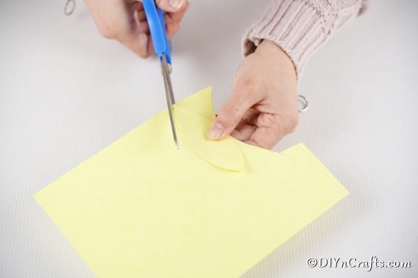 Cutting wings out of yellow paper