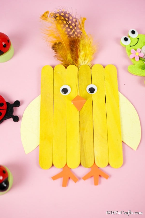 Craft stick chicken on pink table