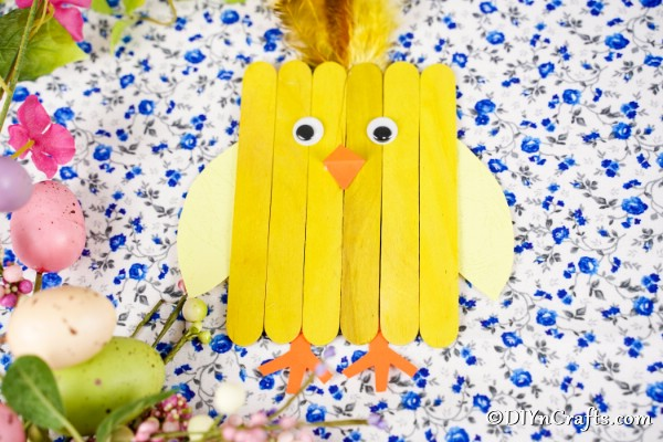 Popsicle stick chick on blue floral paper