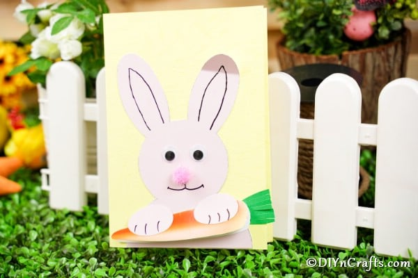 Easter bunny card in front of mini fence