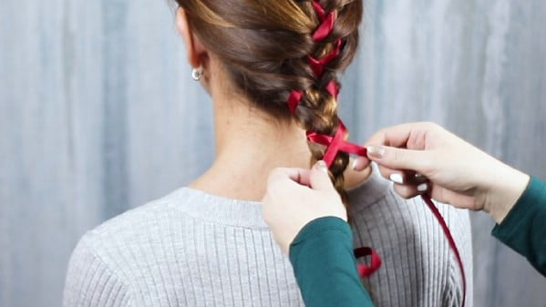 Weaving ribbon into brown hair