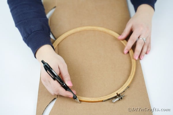 Measuring a wreath shape on cardboard