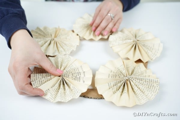 Gluing fan papers on cardboard