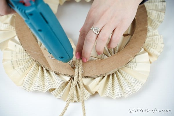 Adding twine to wreath