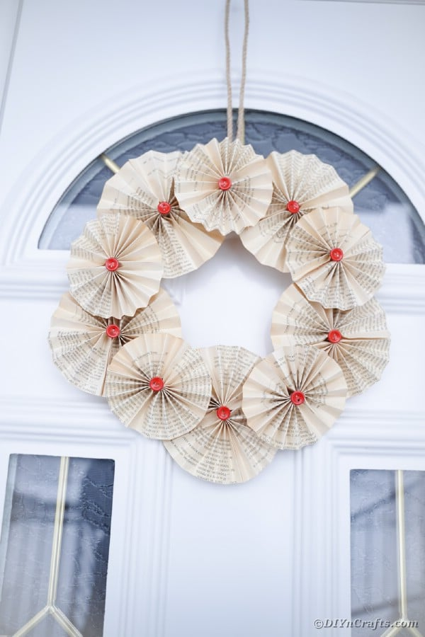Rustic old book page wreath on glass door
