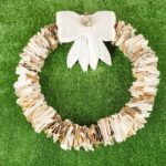 Old book page wreath on grass