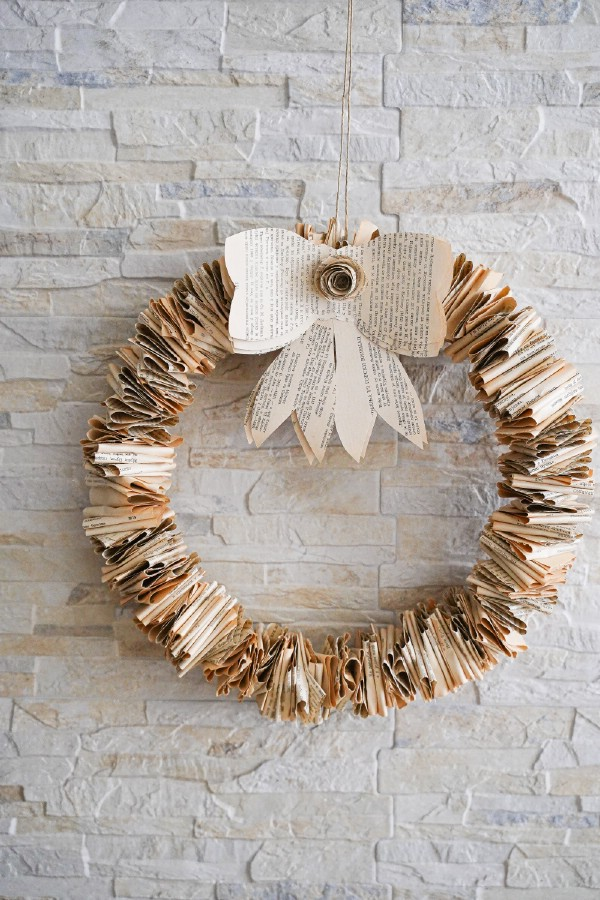 Folded book page wreath on brick wall