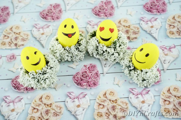 Emoji eggs on flowers