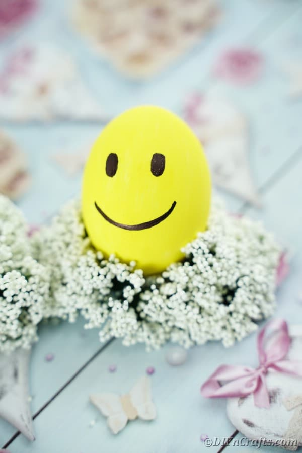 Smiling emoji Easter egg on babies breath wreath