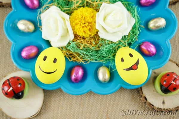 Emoji Easter eggs on blue egg tray