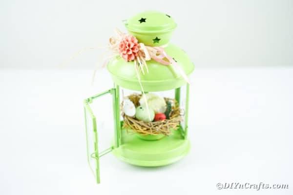 Green spring lantern on white table