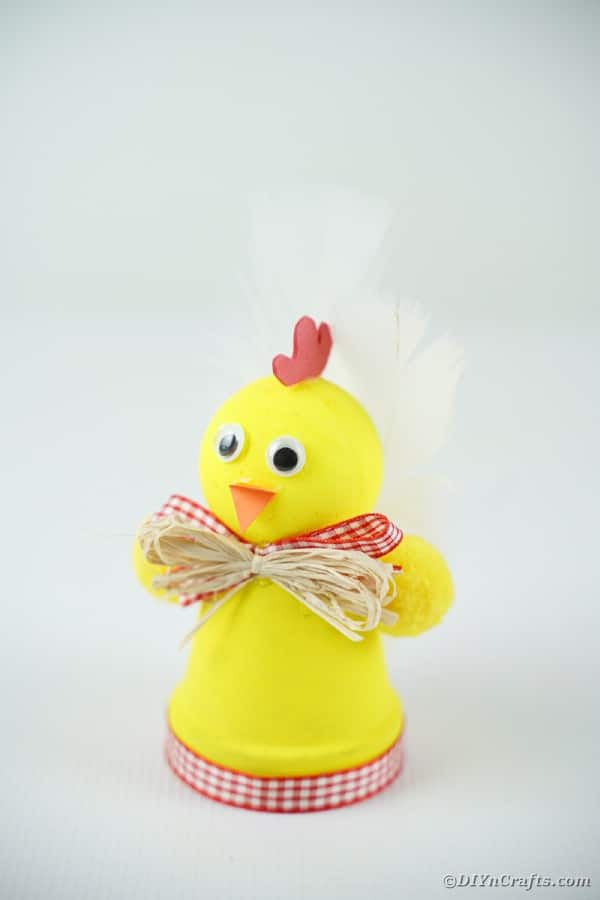 Yellow chicken on white surface