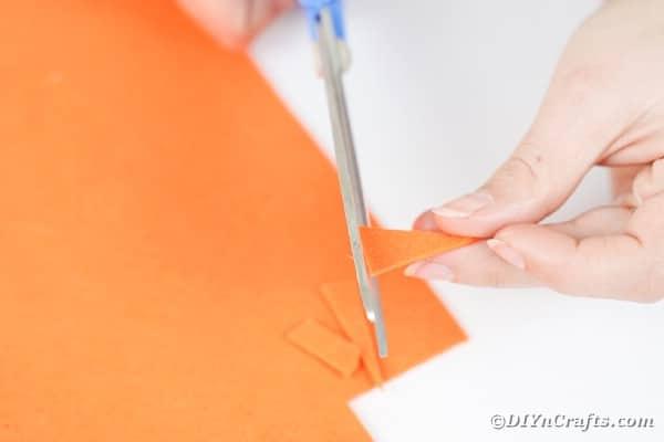 Cutting beak out of orange paper