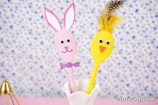 Wooden spoon bunny and chick by floral background