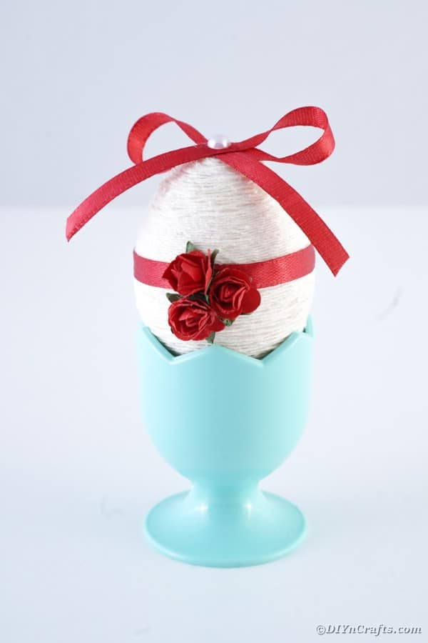 Blue egg cup with white and red egg