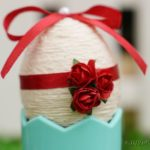 Yarn egg in blue cup