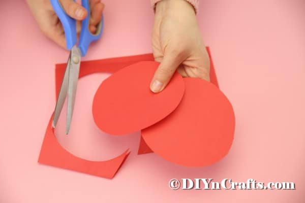 Cutting circles from red paper