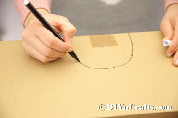 Drawing a half circle on cardboard box