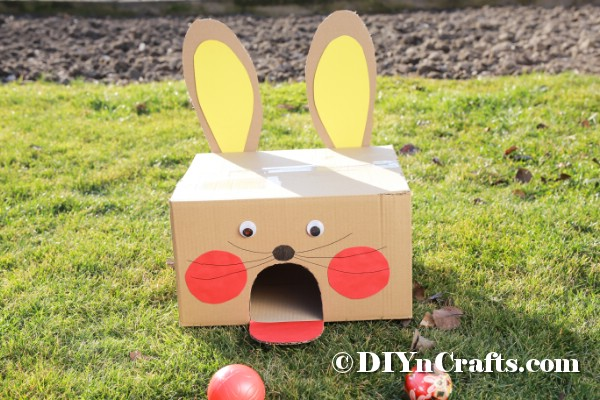Cardboard box bunny on grass