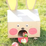 Cardboard bunny ball toss game on grass