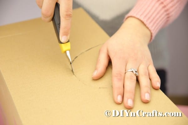 Cutting hole in cardboard box