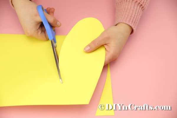 Cutting yellow paper into ear shapes