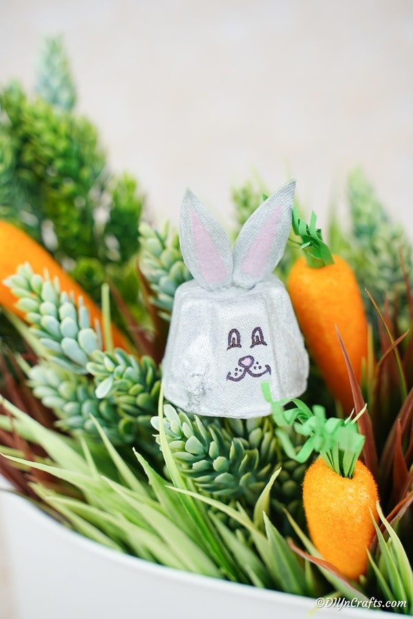 Egg carton bunny in basket of greenery