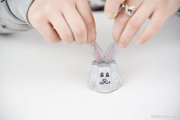 Gluing bunny ears to egg carton
