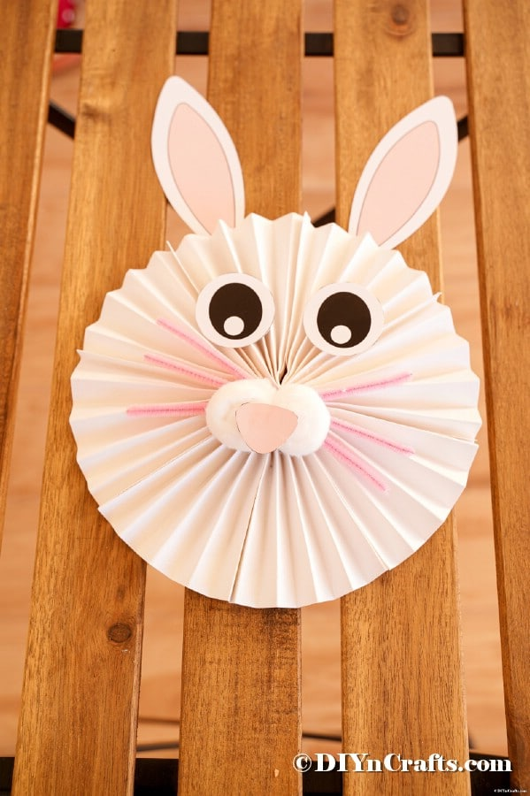 Paper fan bunny on wooden surface