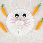 Paper fan bunny on lacy tablecloth