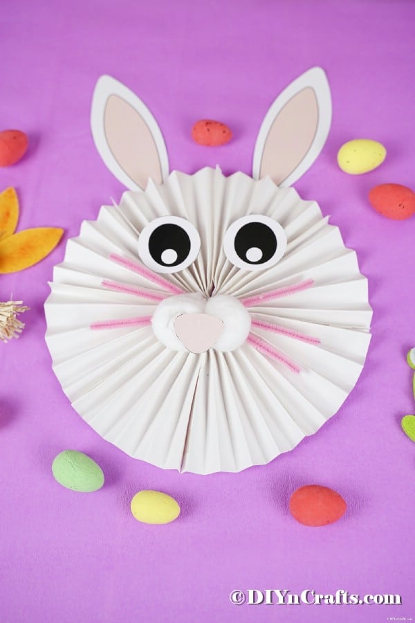 Paper fan bunny on purple background