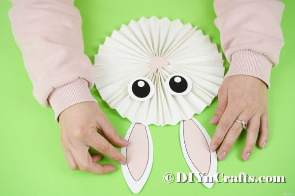 Gluing bunny ears onto the paper bunny