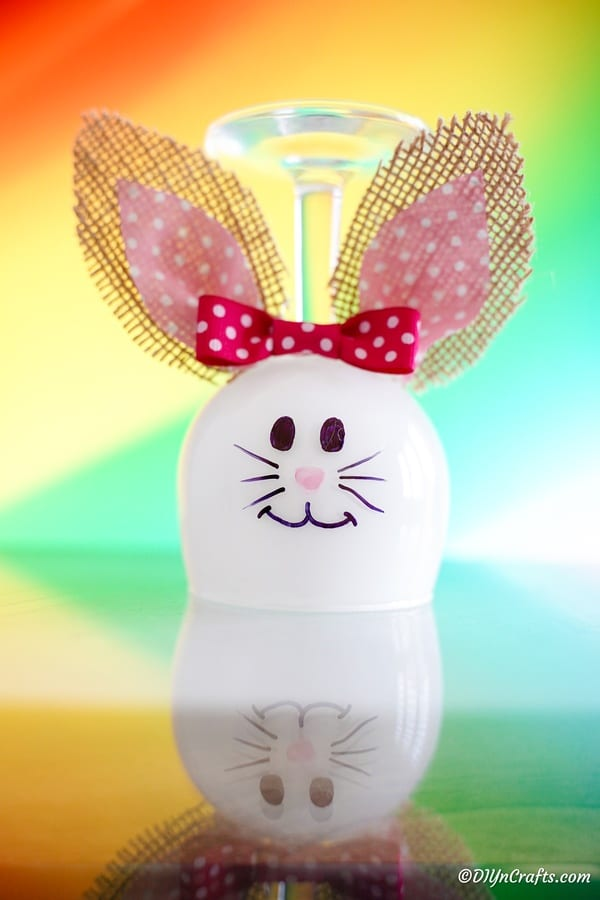 Glass bunny in front of pastel background