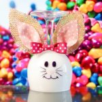 Wine glass bunny in front of colorful background