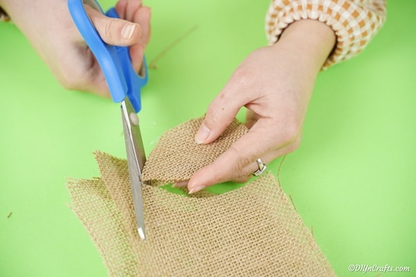 Cutting ears out of burlap