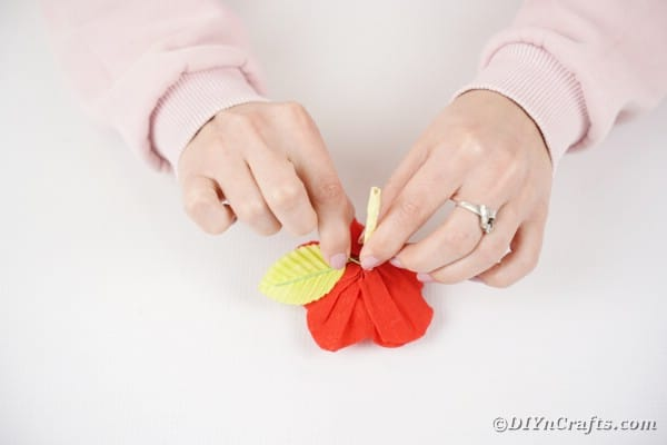 Adding leaves to paper flower pop