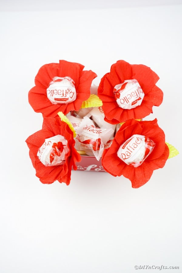 Red paper flowers on chocolates