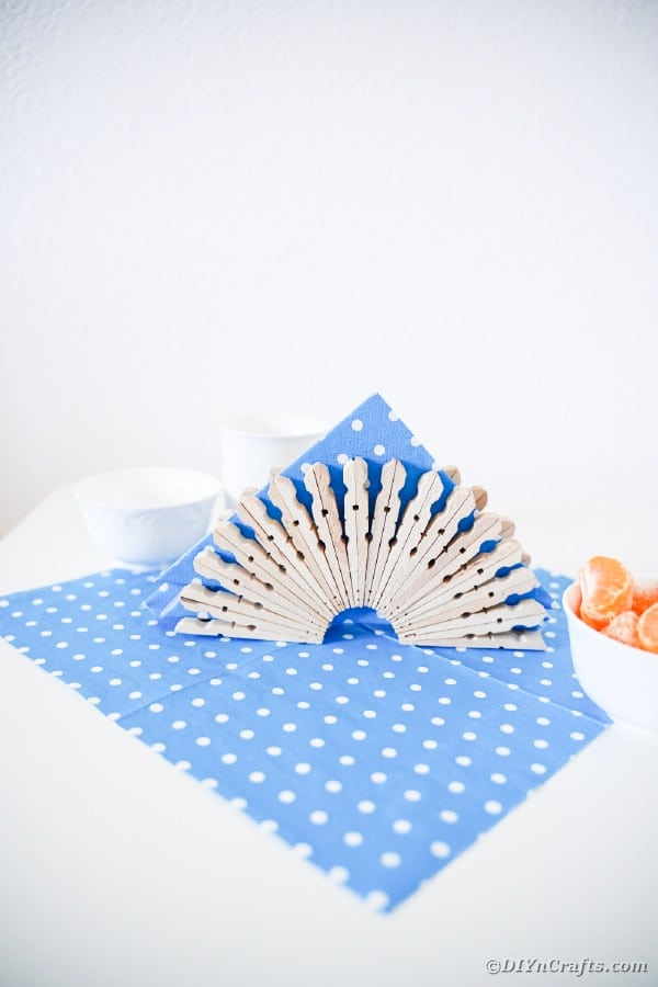 Clothespin napkin holder on blue and white polka dot cloth