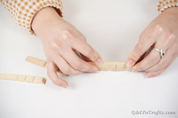 Single clothespin being glued