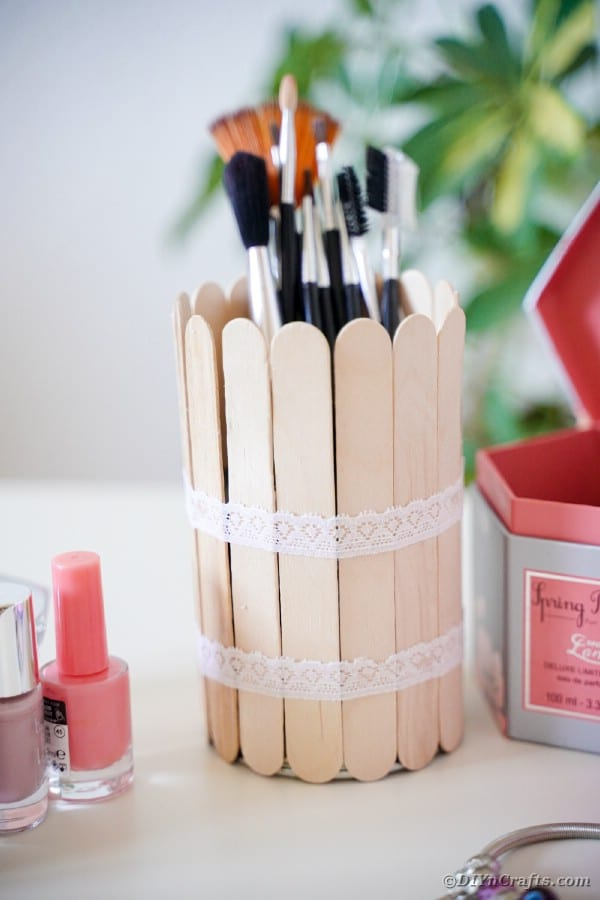 Craft stick tin can filled with makeup brushes