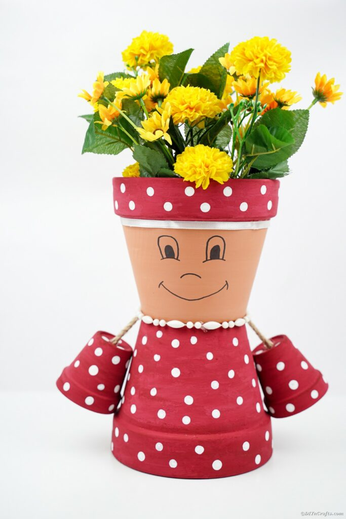 Flower pot lady in front of white background