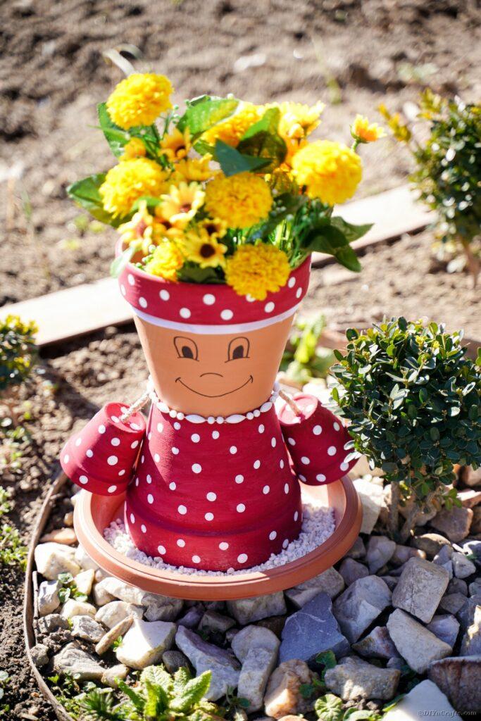 Flower pot girl in garden