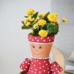 Flower pot girl on wooden table