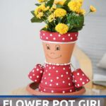 Flower pot person with pink and white polka dots