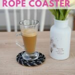 Rope coaster with tall glass on table